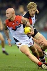 Heads-up: Melbourne's Nathan Jones evades St Kilda's Rhys Stanley on Saturday night.