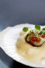 Scallop with salmon caviar.