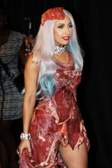 Lady Gaga wears her controversial meat dress, as she arrives in the Press Room after winning eight 2010 MTV Video Music Awards.