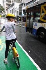 Brisbanetimes.com.au journalist Courtney Trenwith on a CityCycle rental bike.