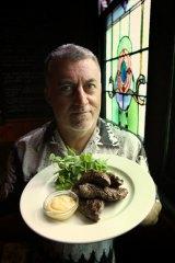 Skip the entree: Guy Lawson with a kangaroo dish at the Napier Hotel.