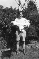 Juggling act ... Lionel with his two babies in June 1946.