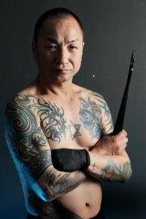 Horihiro with his bamboo sticks.