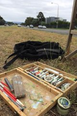 Canberra artist Christopher Oates' tools of his trade in his unusual workspace - the middle of Adelaide Avenue - on Wednesday.