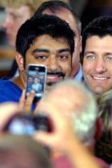 Crowd-puller … Paul Ryan, right, meets supporters.