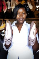 Rosety Nakato with a pair of Witchery heels at Kampala roadside boutique.