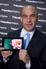 Jim Balsillie, co-chief executive officer of Research In Motion, holds up the PlayBook tablet computer during a Bloomberg Television interview in New York.