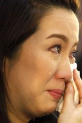 Sad day ... Kris Aquino at her mother's funeral.
