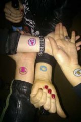 """Foursquare users tattoo their """"badges""""."""