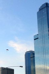 Base jumpers parachute from the Rialto.