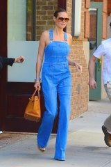 If your overalls are fitted enough, you can go sans top underneath, like Heidi Klum.