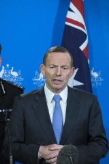 Prime Minister Tony Abbott speaks to the media during a press conference on Friday. Photo by Luis Ascui/Fairfax Media via Getty Images