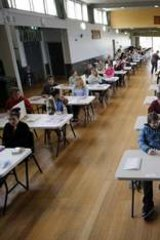 Warrnambool College Year 12 VCE students wait as their VCE English exams are collected.