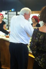 Is it teriyaki beef? Or perhaps a California roll? Clive Palmer orders sushi.