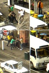 Street brawl ... an office worker snapped photos of a mid-afternoon brawl in Swanston Street.