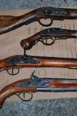 Police found a number of weapons at the home of the man who was allegedly driving the ute which hit Richard Warburton.
