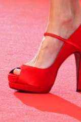 The shoes of actress Frederique Bel as she arrives on the red carpet for the screening of Habemus Papam (We Have A Pope) at the Cannes Film Festival.