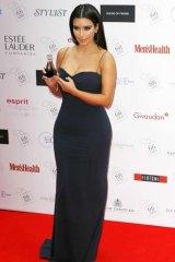 Hawking her perfume ... Kim Kardashian at the FiFi UK Fragrance Awards in London.