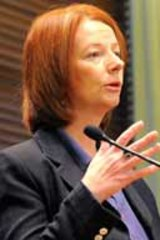 """[The government] will not succumb to threats...Julia Gillard."