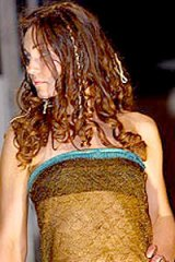 Prince-catcher: Kate Middleton models the dress in 2002.