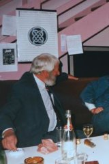 Red Symons (right) on McPhee Gribble's well-used red couch.