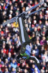 Jacqui Cooper performs in the women's freestyle skiing aerials qualifications.