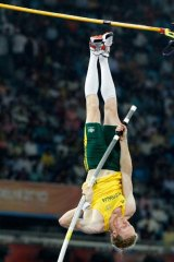 Flying . . . Steve Hooker capped a long season with gold.