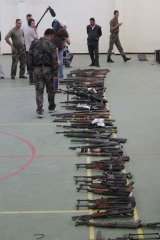 Syrian troops display weapons allegedly seized from armed dissidents.