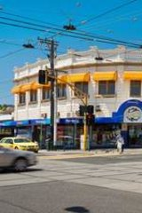 An Asian investor has paid $1 million above the odds for Stotts Corner in Hawthorn.