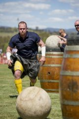Focused: Strongman Moe Westmoreland moves in for the challenge during the Stones of Manhood competition at the Canberra Highland Gathering & Scottish Fair in Kambah.