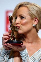 Top spot: Carrie Bickmore poses with her Gold Logie award.