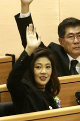 A nation divided ... Thai Prime Minister Yingluck Shinawatra, front, votes in parliament.