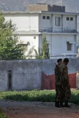 Soldiers keep guard around a compound within which al-Qaeda leader Osama bin Laden was killed in Abbottabad May 3, 2011.