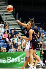AIS player, Alexandra Button in action last year. The AIS will not play in the WNBL next season.