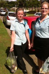 """Woolies employees Debbie Bunk (left) and Madeline Van Eeghen. """"It is just too expensive to pay $20 a day."""""""