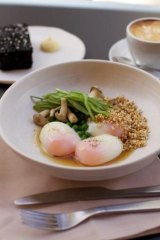 Best in class: The 63-degree eggs in burnt onion consomme with a side of grilled licorice bread.