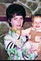 Days of innocence: Carrie, aged 16 months, with her mother.