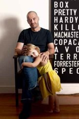 Daddy's girl: Adam Spencer with his daughter Olivia at their Newtown home.