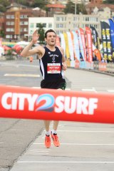 Craig Mottram crosses the line in the City2Surf.