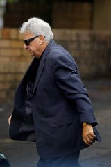 Ron Coles … arriving at Gosford police station.