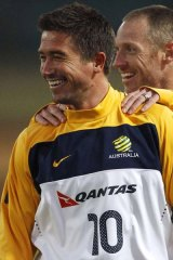 Australia's Harry Kewell (L) and Craig Moore smile during a practice session at Ruimsig stadium in Roodepoort.