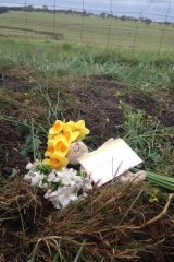 Flowers on the Gisborne South grave site.