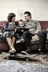 Rolling with it: Pappas at home with his partner, Helen Norman, and son Billy.