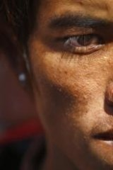 Grieving: Avalanche survivor Sete Tamang waits to receive the bodies of his colleagues outside a morgue in Katmandu.