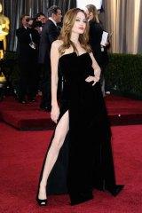 Angelina Jolie arrives at the 84th Annual Academy Awards.