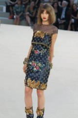 Flower power: Kershaw on the runway for Chanel in Paris in 2010.
