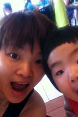 A mother's pride and joy: Missing passenger Gu Naijun with one of her children.
