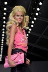 A model walks for Moschino at Milan Fashion Week, 2014.