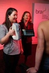 Phd student Celeste Coltman testing a participant's bra size as Dr Deirdre McGhee, Senior Lecturer Faculty of Science, Medicine and Health a the University of Wollongong, looks on.