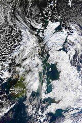 A satellite image shows Britain covered in snow.  Widespread ice and sub-zero temperatures continue to cause disruption across the UK.